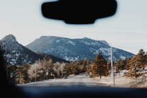 view of a mountain road through a windshield