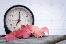alarm clock and calendar with fall leaves