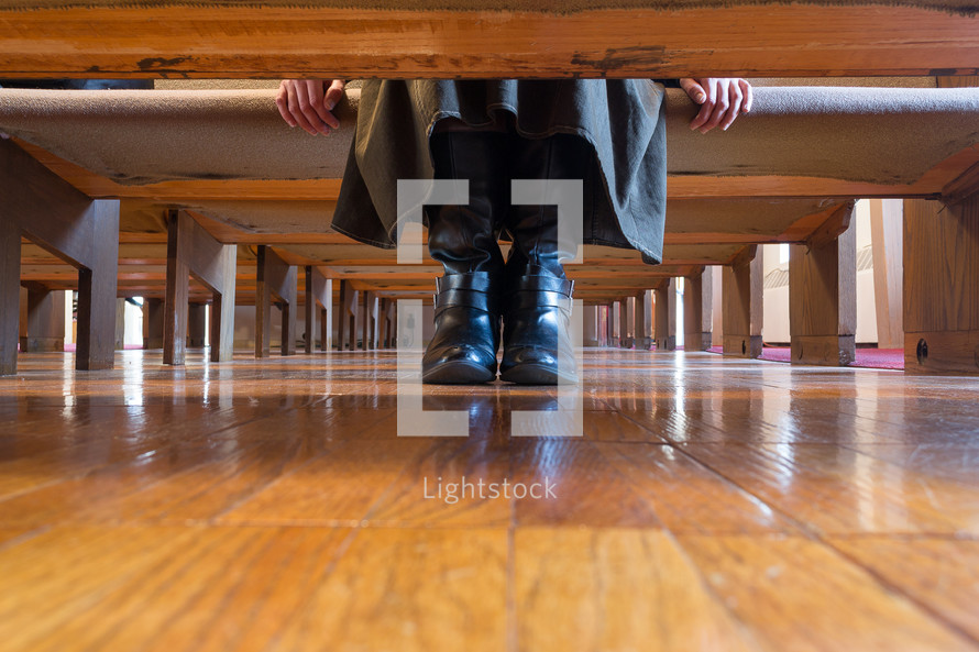 boots under a church pew