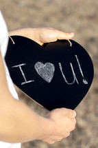 I love you written on chalkboard