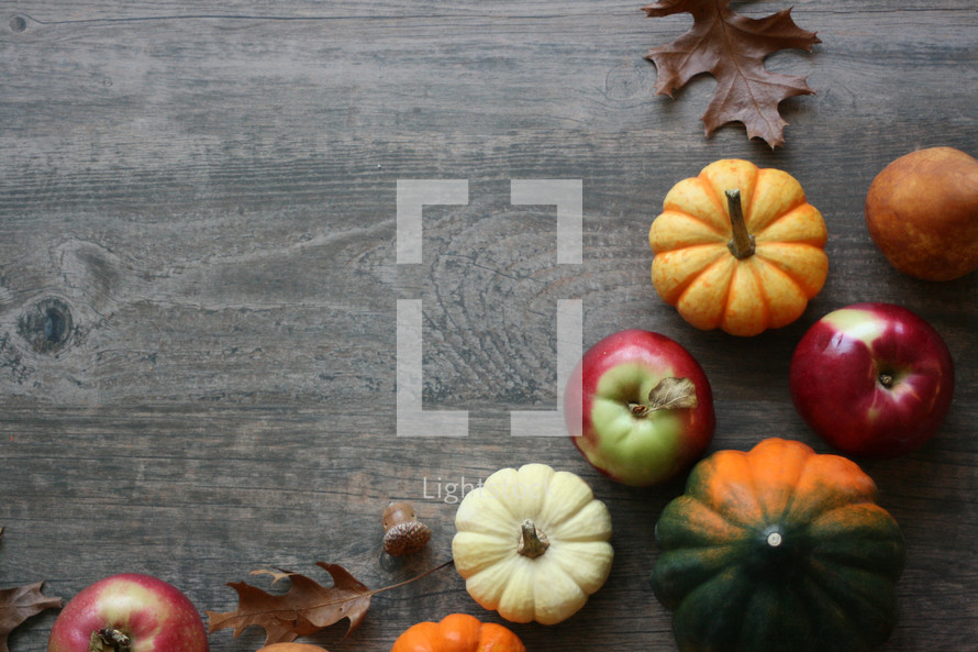 fall background with pumpkins and fruit