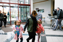 families walking through church doors