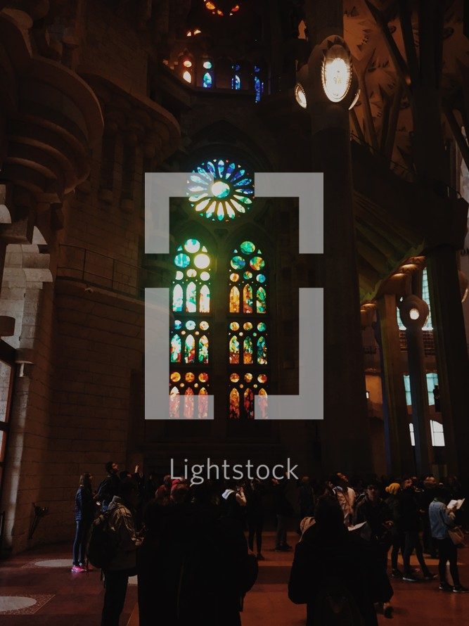 tourists viewing stained glass windows