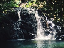 waterfall into a swimming hole