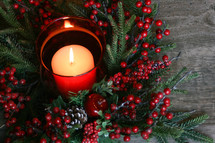 candle and Christmas centerpiece