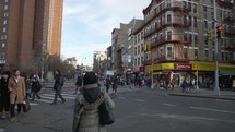 People crossing a crosswalk in China Town NYC