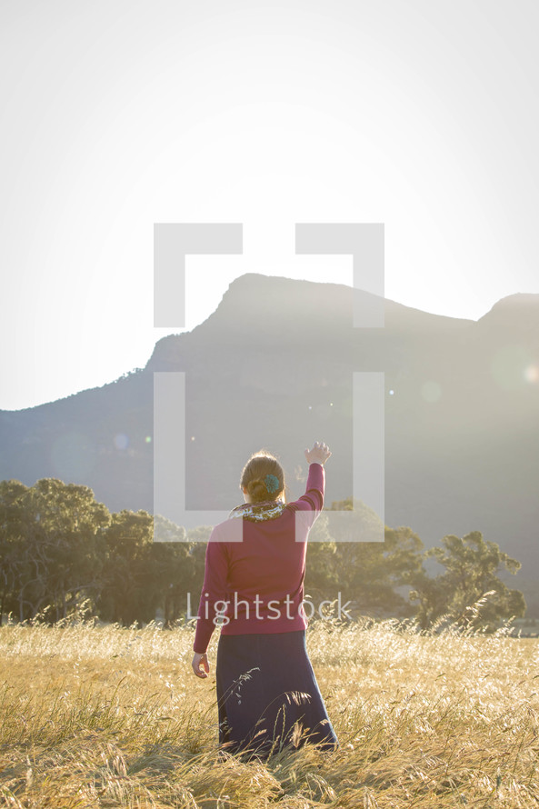 Woman Worshipping God in Field