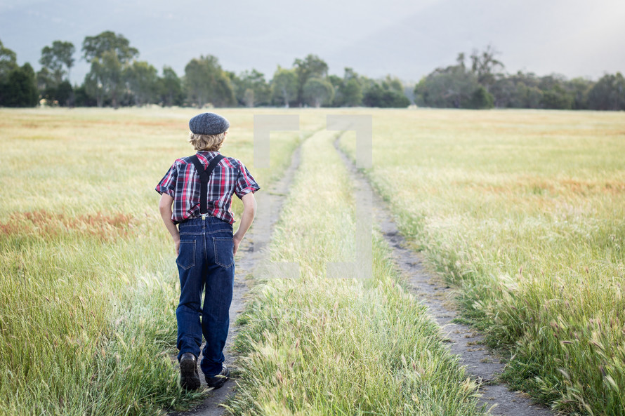 a boy walking in a field