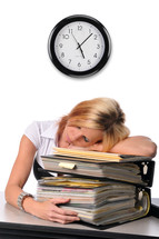overworked woman sleeping on a stack of books