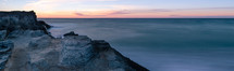 rock cliffs along a shoreline