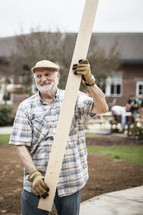 a man carrying lumber