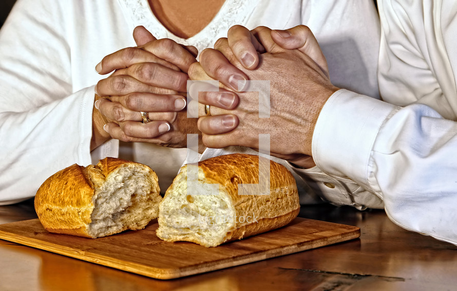 A husband and wife pray together, giving thanks for the blessings of food and spiritual communion with God.