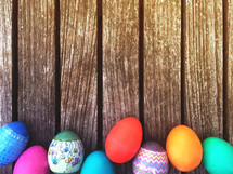 Easter eggs border on wood