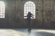 woman dancing in an empty warehouse