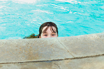 a girl at the edge of a pool