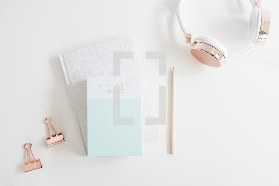 clips, headphones, pencil, and journal