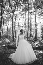 bride standing in the woods
