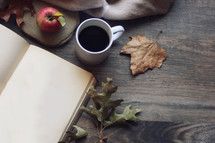 coffee, journal, and fall leaves