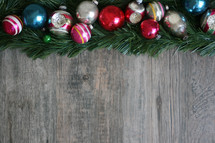 border of Christmas ornaments and greenery