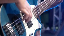 Beautiful shot of a bass guitar with natural light leaks coming in from the side.  Blue overtones, perfect editing clip for contemporary or youth service.  Shot in RAW on Cinema Camera at 2.5k.