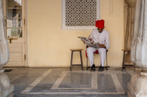 a man in India reading a newspaper