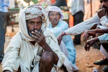 men smoking cigarettes in India