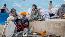 people wrapped in blankets in India