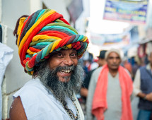 a smiling man with a colorful turban in India