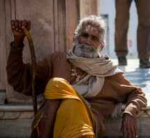 a man with a cane in India