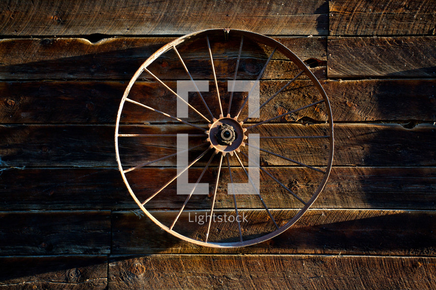 wagon wheel on barn wall