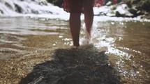 a woman walking in water