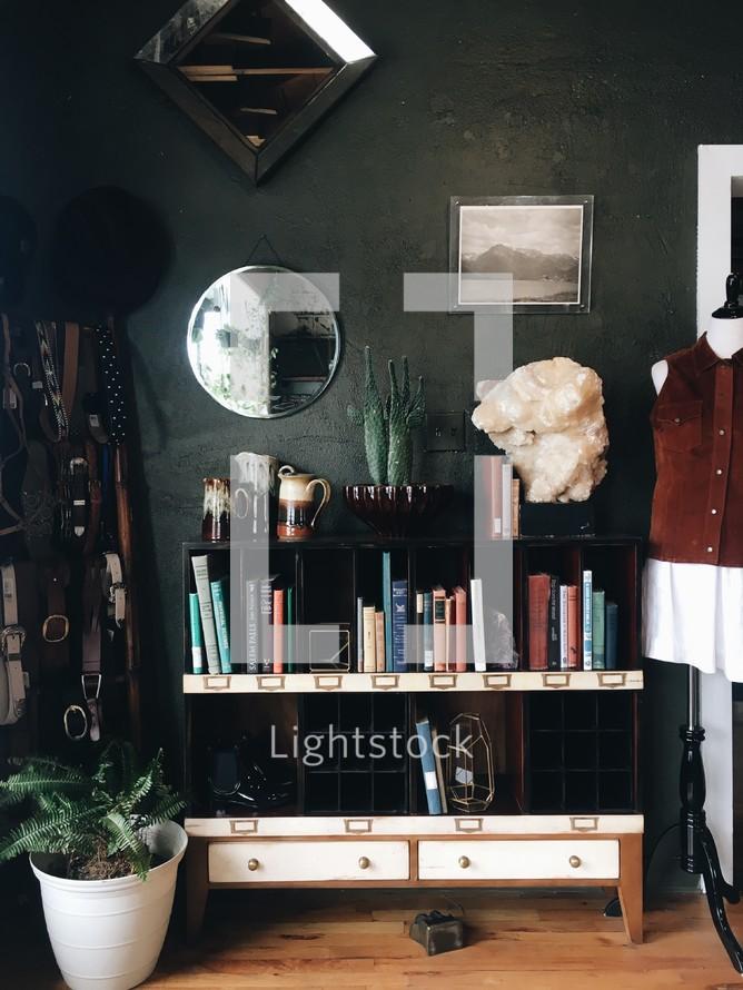 home decor and books on a bookshelf