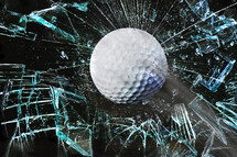 golf ball and shattered glass
