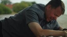 a distressed man on a beach