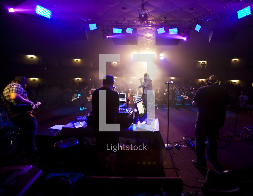 band singing on stage at a concert - Blacklight tour