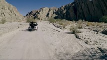 driving through the desert in a Jeep