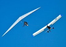Hang glider being towed into the air