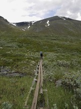 person hiking highlands in Northern Sweden