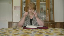 a woman reading a Bible