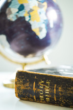 globe and Holy Bible