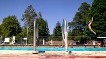 children jumping off a diving board