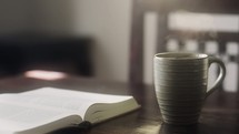 open Bible and a steaming cup of coffee