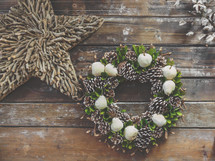 Christmas pine wreath and star in farmhouse barn wood