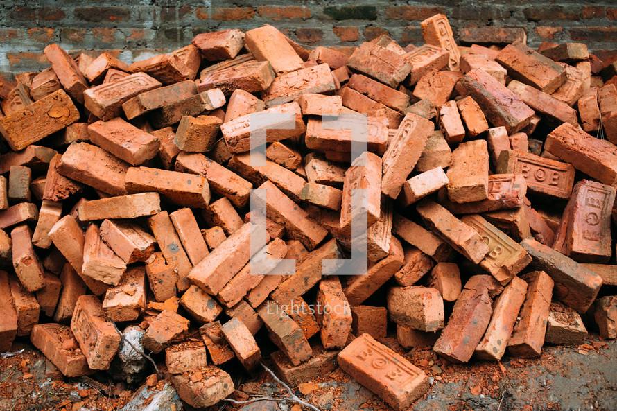a pile of old bricks, earthquake rubble