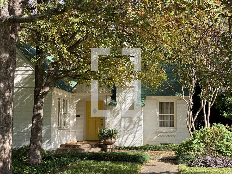 shadows on a small white house
