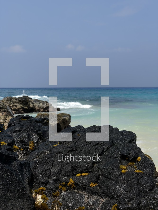 rocks along a beach shore