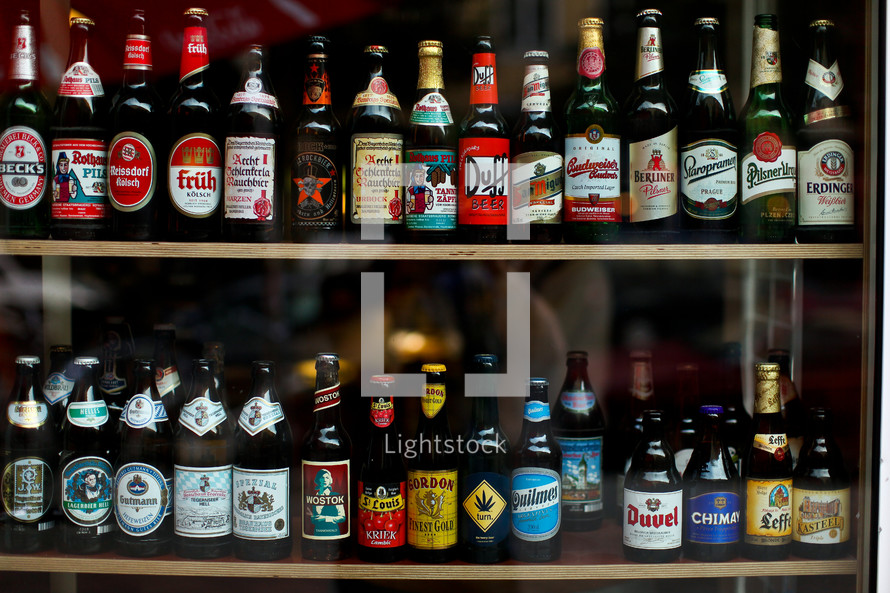 Bottles of beer lined up on two shelves