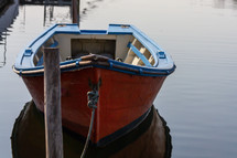 Small boat tied to a dock on a canal in Aveiro, Portugal