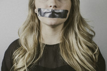 woman with duct tape over her mouth