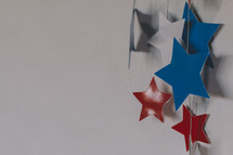 red, white, and blue stars on string